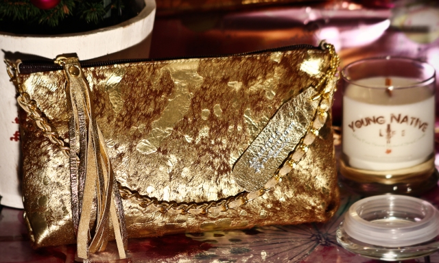 Angela DeMontigny Gold Handbag Promotion