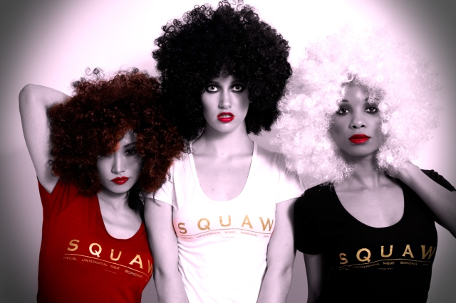 Angela DeMontigny stand behind her SQUAW Tee shirt line