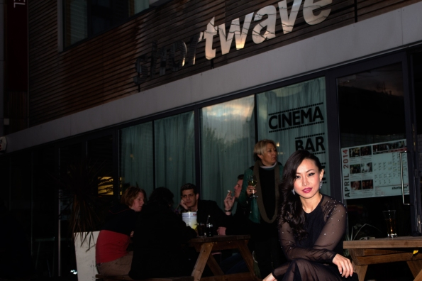 Chinese star Ayi Jihu sits outside the cinema showing her first ever film