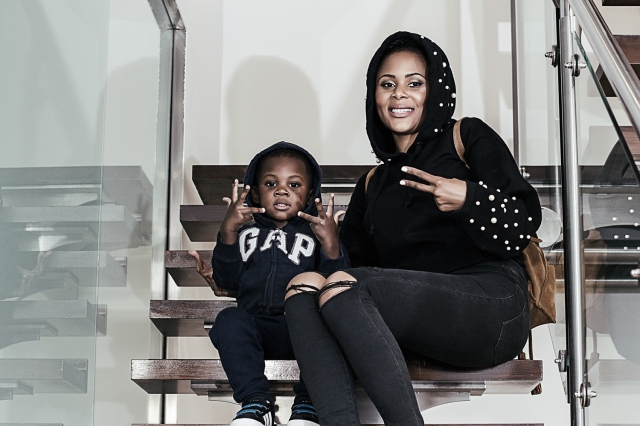African Star Soleil NgoNga and her son Norfolk pose for a picture on the stairs.