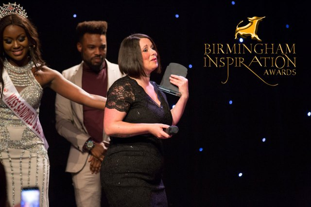An emotional Kelly Elliman picks up one of several awards at the Birmingham Inspiration Awards as host Raven Dixon Biggs and Urban Awards Boss Jordan Kensington look on. Picture by Santoshi Padhiar