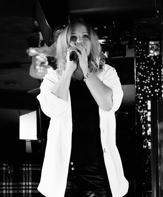 Norwegian Star Beate Jacobsen performs her new song Lucky to be alive at the G Salvatore Fashion Showcase in Birmingham, UK